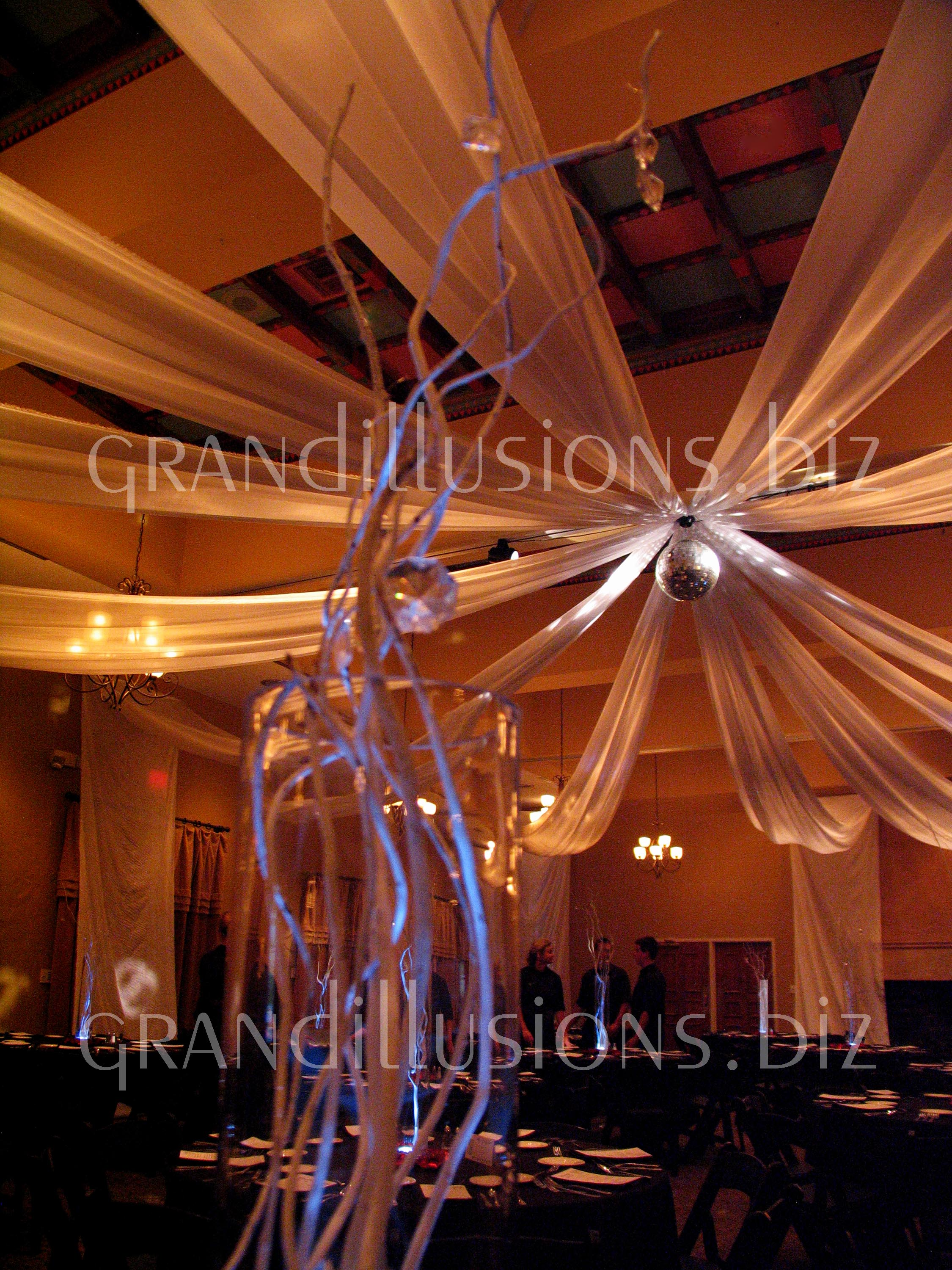 draped ceiling prom with centerpiece grand illusions