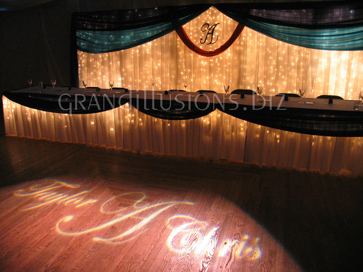 head table icicle backdrop initial letter gobo on floor wedding reception decorating Pla Mor Ballroom Lincoln Nebraska